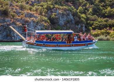 Dalyan, Turkey - August 26, 2007: Tourist boat on the River Dalyan near Dalyan town in Mugla Province