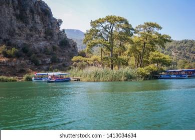 Dalyan, Turkey - August 26, 2007: Tourist boats on River Dalyan near Dalyan town in Mugla Province