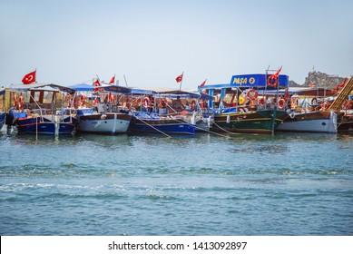 Dalyan, Turkey - August 26, 2007: Fishing boats on the marina between River Dalyan and famous Iztuzu Beach near Dalyan town