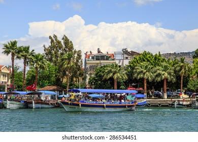 DALYAN, TURKEY - MAY 31, 2015 : Boats for touristic boat trips in the river between Koycegiz Lake and Iztuzu Beach in Dalyan.