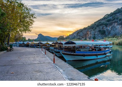 Dalyan, Turkey - October 31, 2018 :Boats view at slope of Lycians rock tombs in Dalyan Town