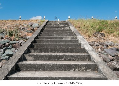 Dam up the cement stairs with blue sky