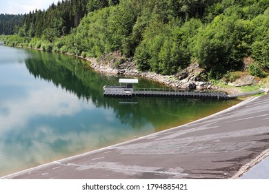 A dam in the forest in Germany. Reservoir pier.
