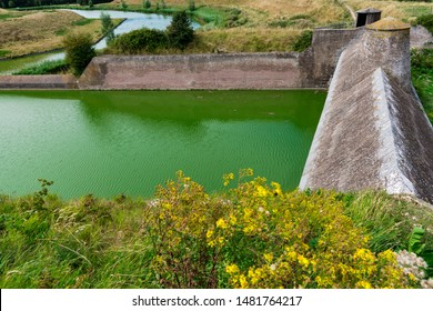 Dam and green water in Veere. The Netherlands