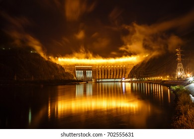 Dam of hydroelectric power station on the Yenisei River in Russia, night shooting on long endurance