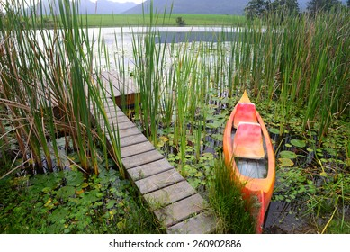 Dam with jetty and canoe in the Garden Route, South Africa
