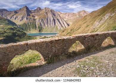 Dam and Lake of Morasco with great mountain on the background seen in a beautiful day of spring season, Riale - Formazza Valley, Piedmont, Italy