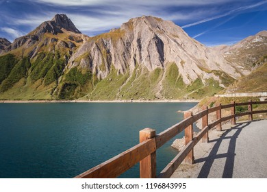 Dam and Lake of Morasco with great mountain on the background seen in a beautiful day of summer season, Riale - Formazza Valley, Piedmont, Italy