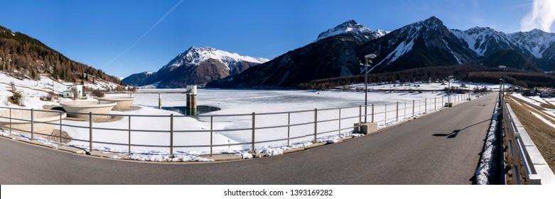 dam at lake Reschensee in Vinschgau, Italy
