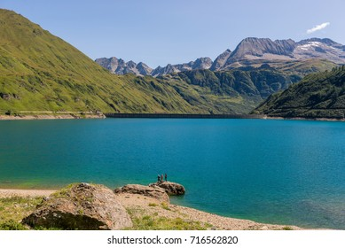 Dam panorama on mountain in sunny summer day outdoor.