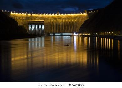 Dam power station in the night light. Sayano-Shushenskaya HPP. Krasnoyarsk region. Russia.