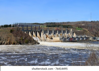 Dam producing energy through water in Mactaquac, outside of Fredericton NB,  Canada
