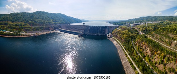 Dam and reservoir of hydroelectric power station, in Siberia on the Enise River shooting from air