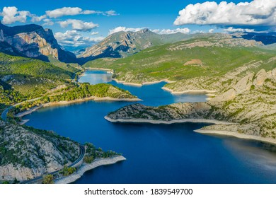 Dam at Segre river, Oliana, Spain, Europe. Mountain peaks landscape
