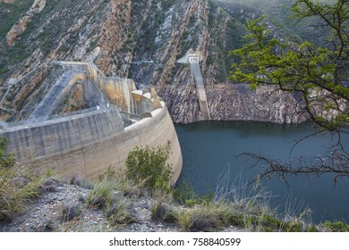 A dam and dam wall in South Africa with low water levels due to drought