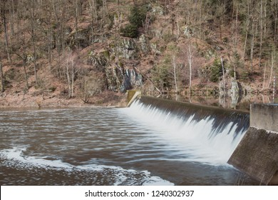 Dam Water Flow, Surface Flow, Flowing Water At Small Water Reservoir Rural