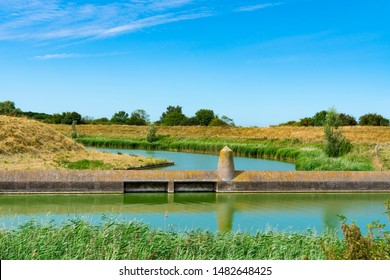 Dam, water and meadow in Veere, The Netherlands