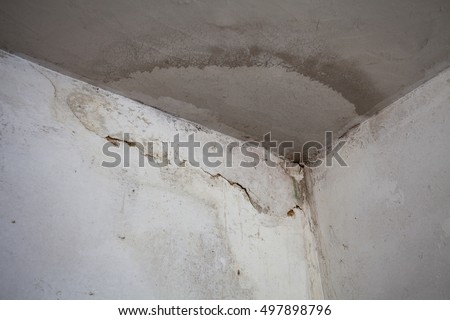 Damage caused by water leakage on a wall and ceiling