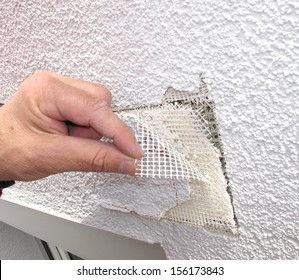 Damage to an outside plaster