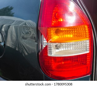 damage to the taillight of the car, accident. Car insurance, background, close-up