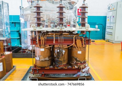 Damage three phase oil immersed transformer showing damage on the core and coils