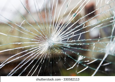 damage, violence, vandalism and danger concept - broken glass with cracks