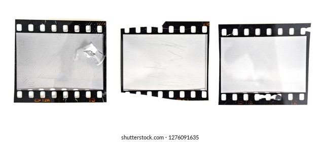 damaged 35mm film strip or frame on white, scratches and signs of usage