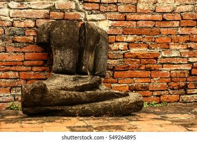 Damaged ancient Buddha statue at Wat Mahathat Ayutthaya, Thailand.