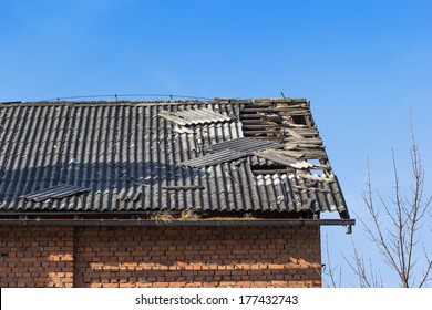Damaged asbestos roofing material
