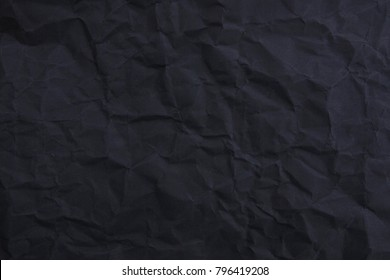 damaged black paper texture as easy background