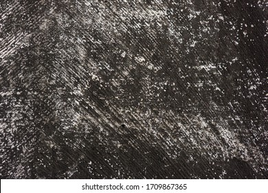 damaged black plaster surface with traces of scratches. Background for design.