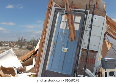 A damaged blue front door is all that is left after an EF5 tornado paid a visit to this home in Joplin, Missouri in May of 2011.