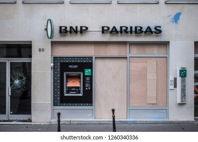 "A damaged BNP PARIBAS bank with wooden panels protecting the main windows, during the ""Yellow Vests"" antigovernment protest in French capital. Paris, France - December 8, 2018"