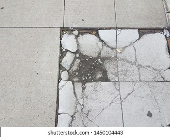 damaged or broken grey cement tile or sidewalk