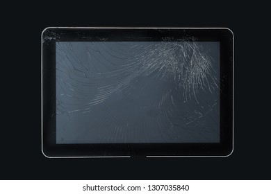 Damaged broken screen glass on modern tablet device isolated on black background with clipping path included