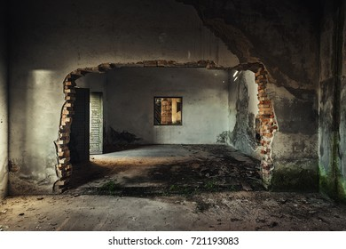 Damaged building interior with large hole