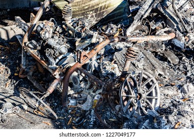 damaged burnt car metallic after arson fire with burnt debris after intense burning fire disaster ruins waiting for investigation for insurance