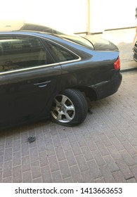 damaged car with broken wheel