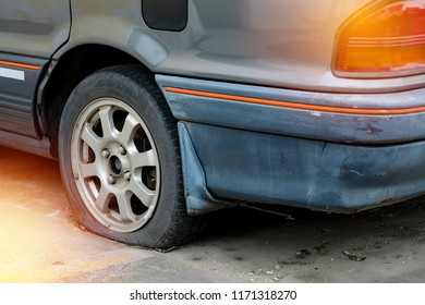 Damaged car and flat tire.