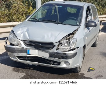 Damaged Car On The Road