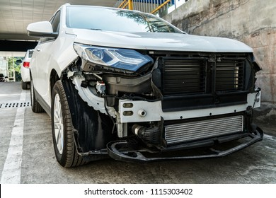 A damaged car, a traffic accident