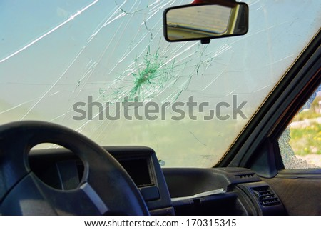 Damaged car window after a crash