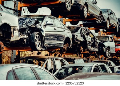 Damaged cars waiting in a scrapyard to be recycled or used for spare part