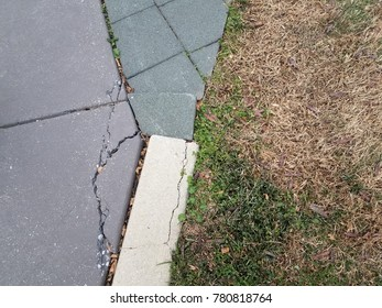 damaged cement and stone tile