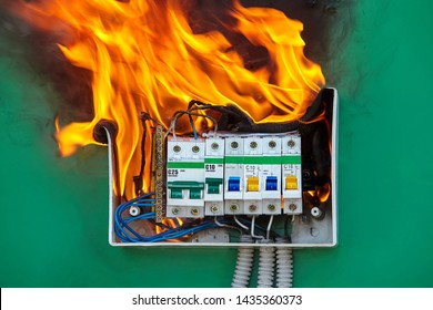 Damaged circuit breaker became the cause of electrical short circuit and caused the switchboard to ignite of fire. Bad electrical wiring systems caused fire inside electrical fuse box of home wiring.