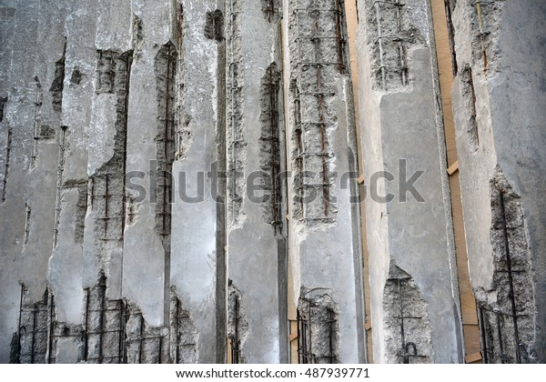 Damaged Concrete Walls Exposed Steel Reinforcements Stock