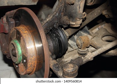 Damaged CV joint duster, hub with brake disk and sterering rod - repair car suspension and gear drive left side
