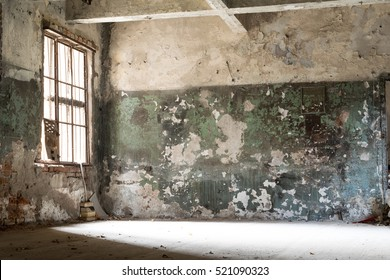 damaged, dirty room of old abandoned building