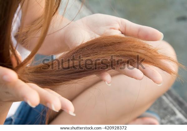 Damaged dry woman hair.