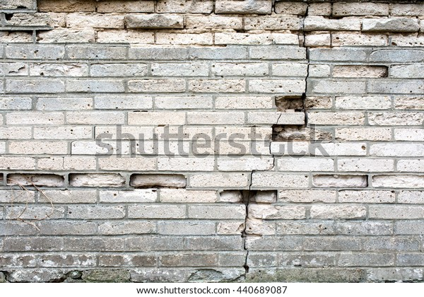 damaged grey brick wall for background or texture
